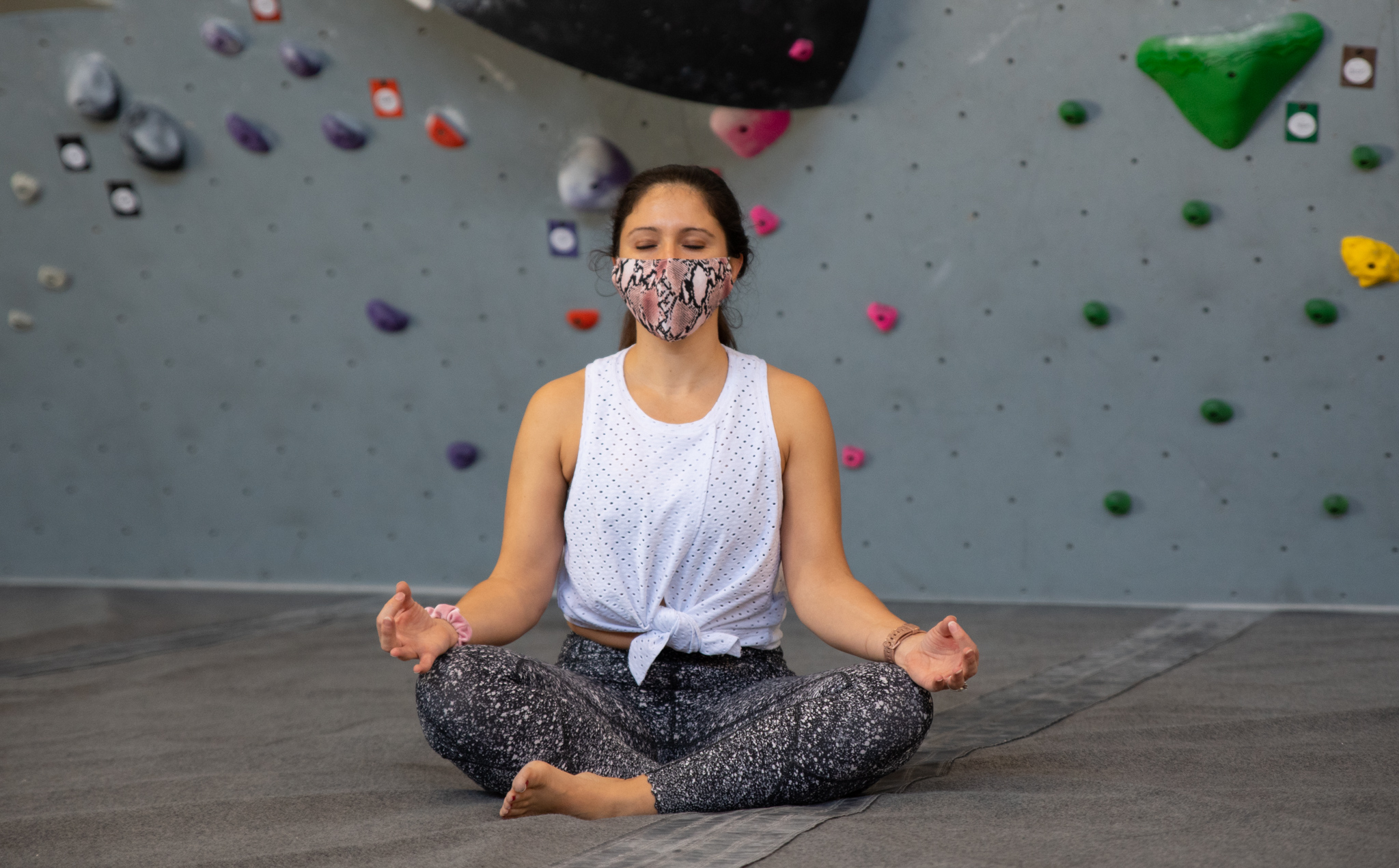 Yoga instructor martha in front of the climbing wall.