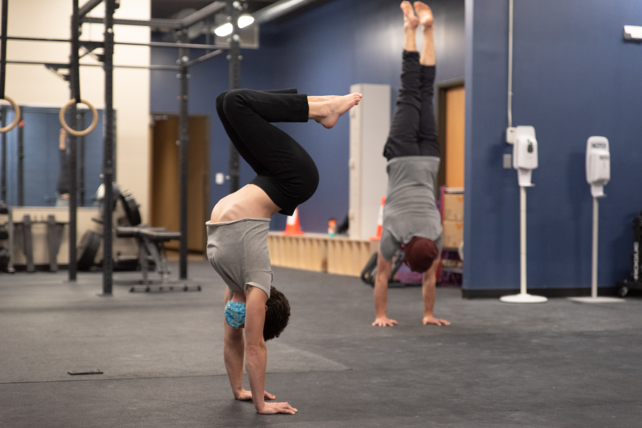 Rock Mill Members Doing Handstands In The Fitness Room